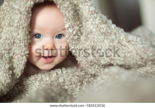 fun baby under blanket