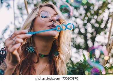 Fun Blonde Blowing Bubbles at a Festival