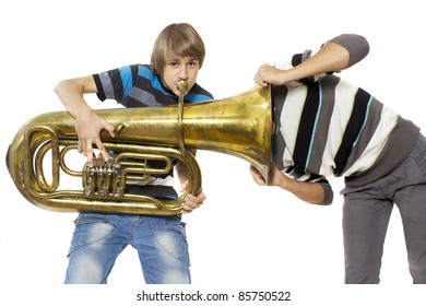 Fun boys enjoy with a trumpet