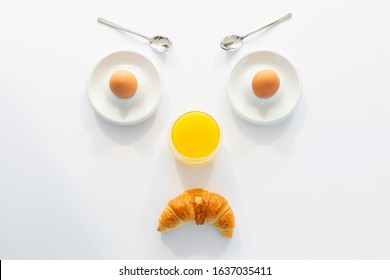 Fun breakfast concept with abstract angry grumpy human face made of breakfast items on white background
