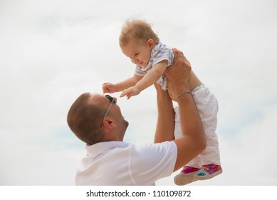 Fun with child on the beach