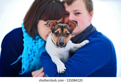 fun couple play with dog Jack Russell in Winter Park