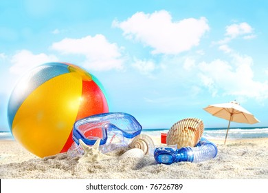 Fun day at the beach with goggles and beach ball