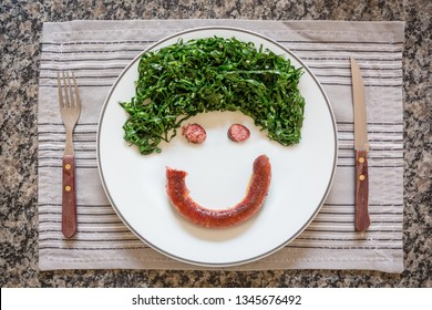 Fun dish with vegetable and sausage, fork and knife