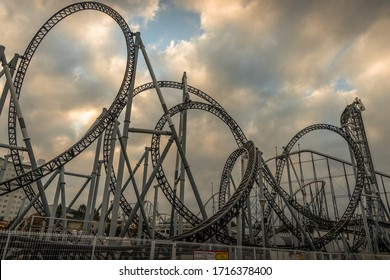 FUN FAIR, MOUNT FUJI, JAPAN- OCTOBER 2019:- Rollercoasters and ferris wheels dominate the skyline in this amusement park in Fount Fuji