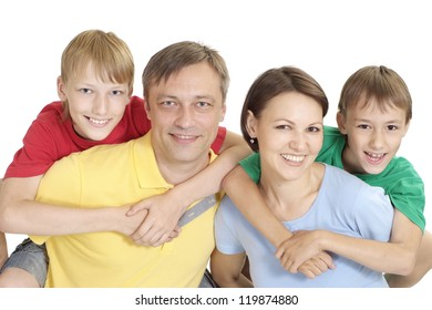 Fun family in bright T-shirts on a white background