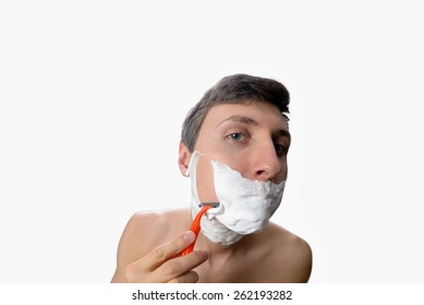 Fun fisheye view of the young man who has a shave on white background