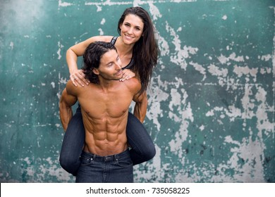 A fun fit couple with six pack abs play and flirt together with healthy strong muscular bodies