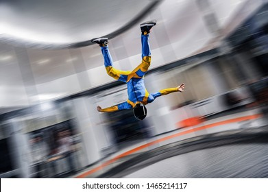 Fun fly. Free fall in Indoor skydive. Action fly sport in wind tunnel. People fall on high speed