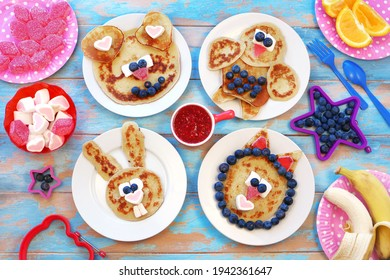 Fun food for children. Set of plates with funny pancakes. Creative idea for kids breakfast
