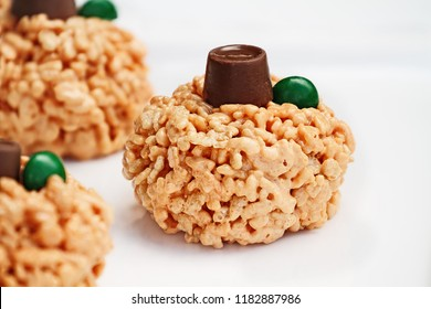 Fun food for kids. Crispy rice and marshmallow treats in the shape of mini pumpkins for Halloween.