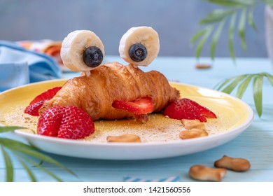 Fun Food for kids. Cute crab croissant with fruit for kids breakfast