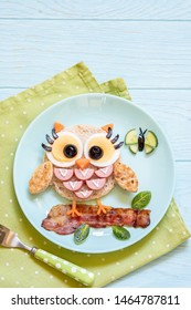 Fun food for kids - cute little owl sandwich toast with sausages and eggs