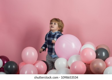 Fun game for child. Happy kid in kindergarten or at a party. A boy is looking up on a pink background. Beautiful child. Children's expectations, happy childhood. Dreams and Hopes