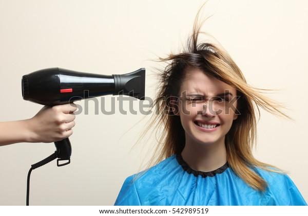 Fun girl hair dry.