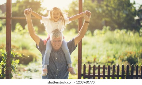 Fun with grandpa. Grandfather and granddaughter spending time together in nature. Copy space.