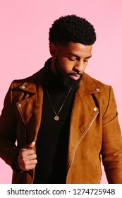 fun, handsome and cool African American man with beard,  isolated on pink studio background