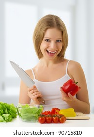 fun happy young woman preparing vegetarian food, vegetables in the kitchen
