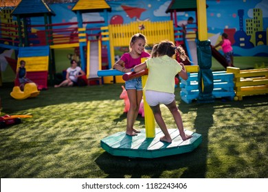 Fun is here. Two little girl playing together. Copy pace.