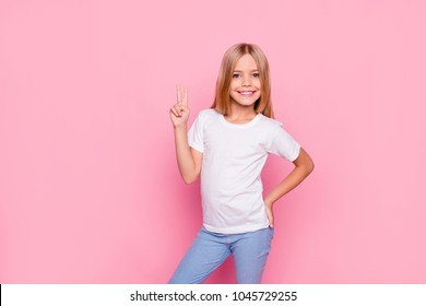 Fun joy enjoy people person funtime concept. Portrait of cute lovely carefree confident sweet adorable beautiful girl in casual modern outfit demonstrating v-sign isolated on pink background