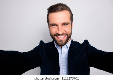 Fun joy enjoy people rest relax concept. Close up portrait of cheerful handsome excited delightful emotional freelancer taking a selfie wearing stylish modern blazer isolated on gray background