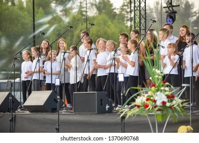 Fun kids singing songs on stage. Concert in honor of the festival of songs and dances. Rezekne - Latvia, June 2016