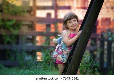 Fun little girl in the garden.
