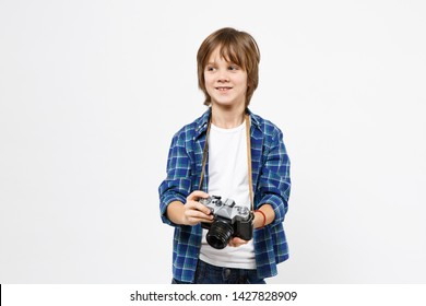 Fun little kid boy in blue t-shirt hold retro vintage photo camera, doing photo shot isolated on white wall background children studio portrait. People childhood lifestyle concept. Mock up copy space