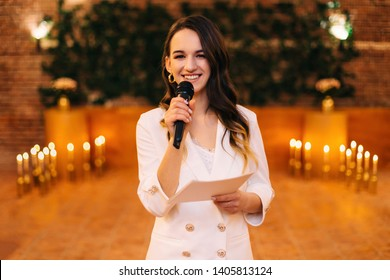 fun master of ceremonies with microphone in hall