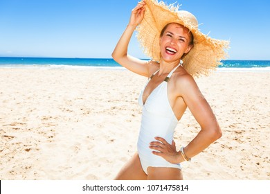 Fun on white sand. Portrait of happy modern woman in swimwear on the beach