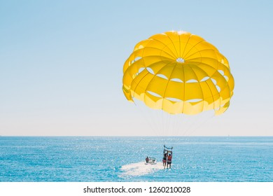 Fun pastime at sea - parasailing with people tied to a boat