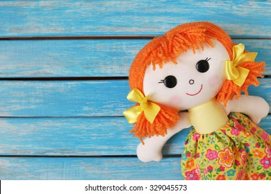 fun rag doll on wooden  background