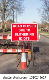Fun road sign informing drivers that the road is closed due to blithering idiots.