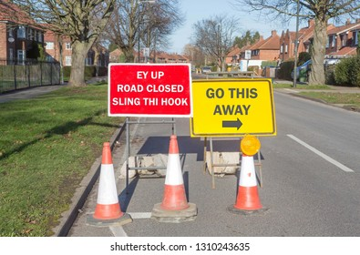 Fun road sign informing drivers that the road is closed and to go another way written in a Yorkshire dialect.