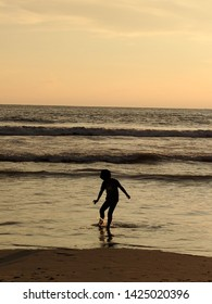 Fun time at the beach. The innocence of a clild with a little splash of sea water. Such a delight to watch a beautiful summer sunset. Image from Payyambalam Beach, Kannur, Kerala