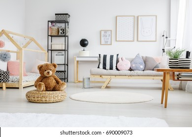Fun white stylish playroom of girl with poster on wall