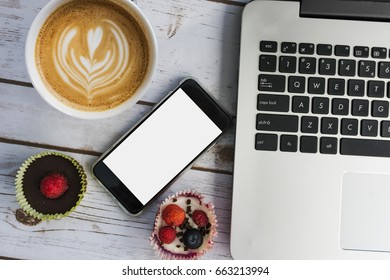 Fun working concept: coffee, smart phone, cupcakes and laptop
