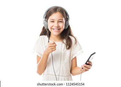 Fun young child enjoying rhythms in listening to music on headphones