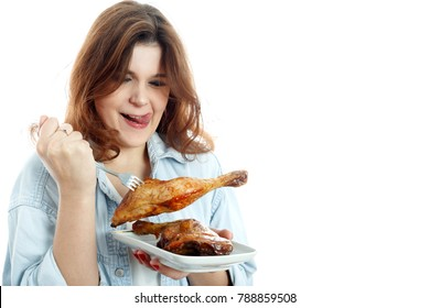 fun young woman eats fried chicken thigh on white background isolated