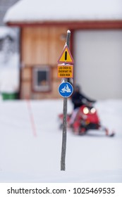 FUNASDALEN, SWEDEN, DEC 29, 2017: Scooter sign in swedish with a scooter driver defocused behind, stating a warning about going out on the ice on your own risk.