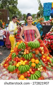 FUNCHAL, MADEIRA - APRIL 20, 2015: A young woman in a Fruits Costume in the Madeira Flower Festival 2015.