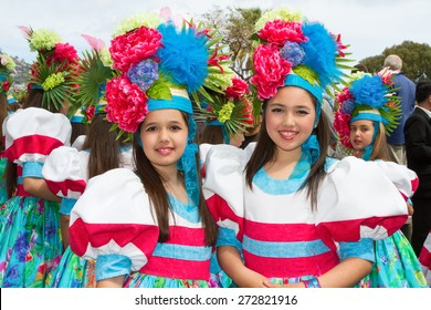 FUNCHAL, MADEIRA - APRIL 20, 2015: Girls with flower headdress at the Madeira Flower Festival, Funchal, Madeira, Portugal