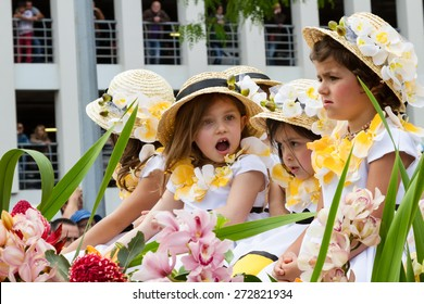 FUNCHAL, MADEIRA - APRIL 20, 2015: Children in floral costumes at the Flower Festival Parade, Funchal, Madeira, Portugal