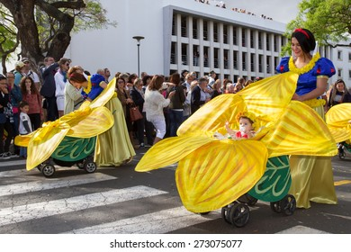 FUNCHAL, MADEIRA - APRIL 20, 2015: Mothers with babies in prams at the Madeira Flower Festival, Funchal, Madeira, Portugal