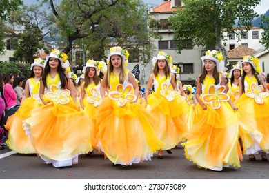 FUNCHAL, MADEIRA - APRIL 20, 2015: Young girls dancing in the Madeira Flower Festival, Funchal, Portugal