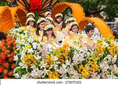 FUNCHAL, MADEIRA - APRIL 20, 2015: Children in a Floral Float at the Madeira Flower Festival Parade, Funchal, Madeira, Portugal