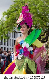 FUNCHAL, MADEIRA - APRIL 20, 2015: Young woman with flower headdress at the Madeira Flower Festival, Funchal, Madeira, Portugal