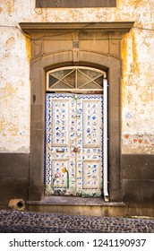 Funchal, Madeira Island, Portugal - May 12, 2017: colorful doors. Fairy-painted doors are one of the main attractions of the town.