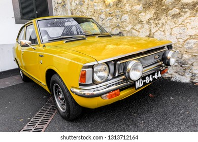 FUNCHAL, MADEIRA - OCTOBER 10, 2015: Beautiful yellow Toyota Corolla E20 SL Coupe in the streets of Funchal, Madeira, on October 10, 2015