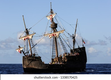 FUNCHAL, MADEIRA - OCTOBER 11, 2015: Beautiful view of tourists on the replica of the Santa Maria, sailing around Madeira island, a popular tourist attraction in summer, on October 11, 2015